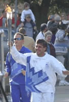 picture of Tatu carrying the Winter Olympic Torch through Dallas